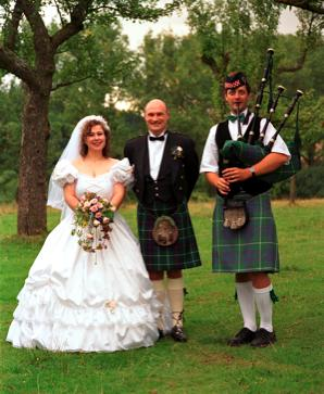 Us and the  piper at our kilt wedding
