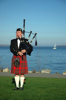 Scottish piper wearing an authentic Scottish kilt