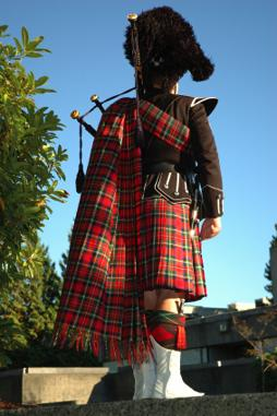 Scottish Piper waiting to play at a wedding