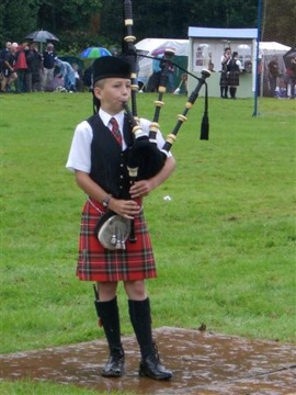 kilts and Scotland boy piper