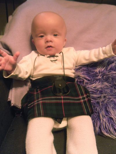 baby kilts Connor in his kilt