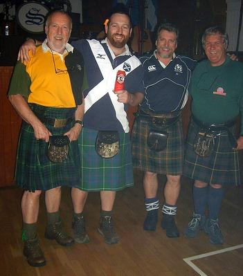 men wearing kilts