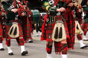 Military pipe band wearing authentic Scottish kilt