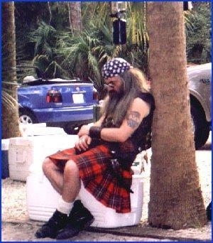 Pedro dressed in his kilt taking a nap