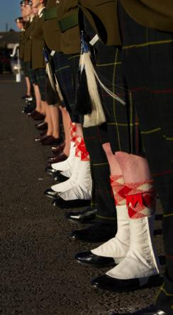 soldiers on parade wearing Regimental Highland Dress